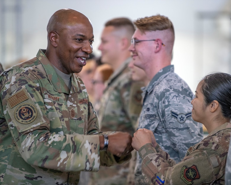Chief Master Sgt. of the Air Force Kaleth O. Wright fist bumps Airmen
