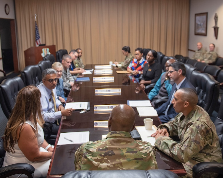 Chief Master Sgt. of the Air Force Kaleth O. Wright attends a briefing from the Travis Air Force Base Care Team