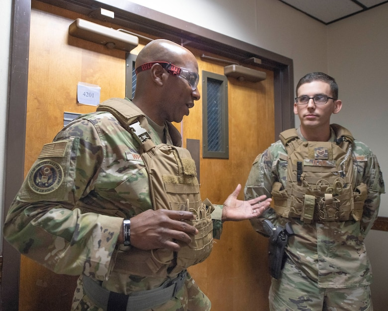 Chief Master Sgt. of the Air Force Kaleth O. Wright speaks to a security forces patrolman.