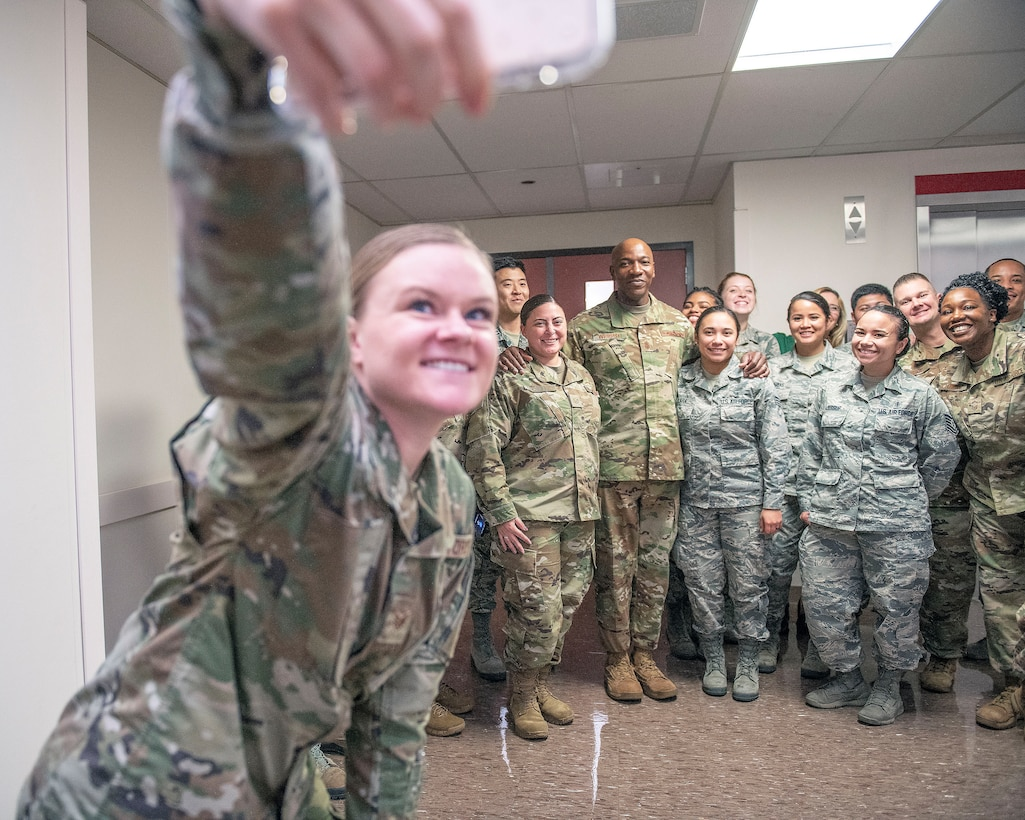 A group of U.S. Airmen take a selfie with Chief Master Sgt. of the Air Force Kaleth O. Wright