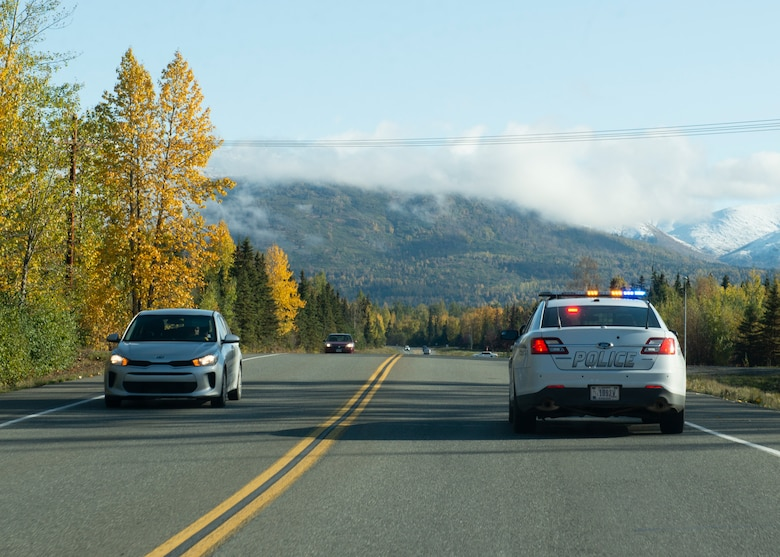 A driver fails to yield to a 673d Security Forces Squadron patrol car displaying emergency lights at Joint Base Elmendorf-Richardson, Alaska, Sept. 26, 2019. Drivers must drive to the right edge of the road and stop when approached by an emergency vehicle displaying its lights.