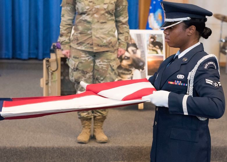 The Mountain Home Air Force Base Honor Guard performs a flag fold at a ceremony held to comemorate MWD Alf V198 September 26, 2019, at Mountain Home Air Force Base, Idaho. Alf served for six years in the United States Air Force and during that time achieved great accomplishments in support of the United States of America. (U.S Air Force photo by Senior Airman Tyrell Hall)