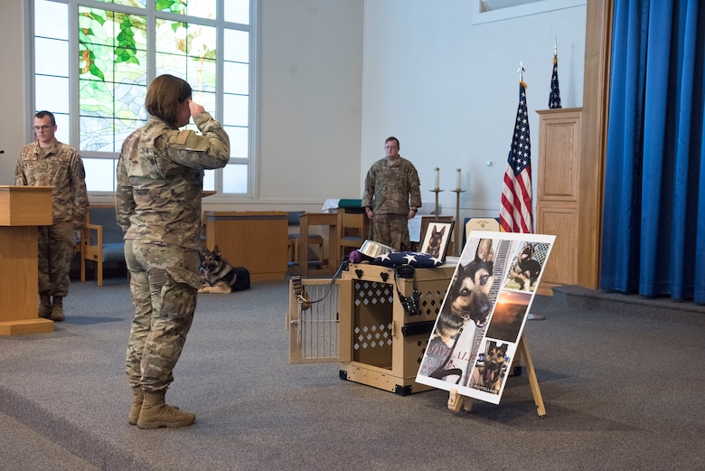 Staff Sgt. Chelsea Uhlry, 366th Security Forces military working dog handler, performs a final salute at a ceremony held to comemorate her MWD Alf V198 September 26, 2019, at Mountain Home Air Force Base, Idaho. Alf served for six years in the United States Air Force and during that time achieved great accomplishments in support of the United States of America. (U.S Air Force photo by Senior Airman Tyrell Hall)