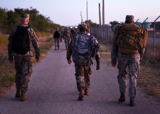 U.S. Air Force members participate in the Jacobson Ruck March on Goodfellow Air Force Base, Texas, September 26, 2019. This ruck is done in remembrance of Airman 1st Class Elizabeth Jacobson, 17th Security Forces Squadron defender, who was killed in Iraq during Operation Iraqi Freedom in 2005. (U.S. Air Force photo by Airman 1st Class Ethan Sherwood/Released)