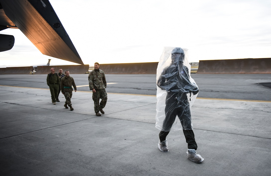 U.S. Air Force Lt. Col Kevin Parsons, right, 93rd Air Refueling Squadron commander assigned to Fairchild Air Force Base, Washington, performs a preflight inspection on a KC-135 Stratotanker while wearing an Aircrew Eye and Respiratory Protection System (AERPS) Sept. 16, 2019, at Fairchild AFB during Exercise Mobility Guardian 2019.