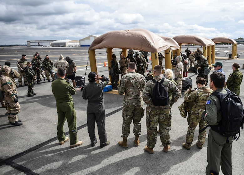 U.S. Air Force aircrew flight equipment Airmen perform decontamination procedures on KC-135 Stratotanker aircrew and passengers Sept. 16, 2019, at Yakima Air Terminal-McAllister Field, Washington, during Exercise Mobility Guardian 2019. Exercise Mobility Guardian is Air Mobility Command's premier, large scale mobility exercise.