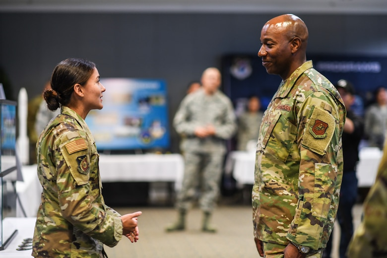 Chief Master Sgt. of the Air Force Kaleth O. Wright speaks with 1st Lt. Alejandra Mejia for a mission area briefing while visiting Los Angeles Air Force Base, El Segundo, Calif., Sept. 26, 2019. While there, he met with Airmen, received mission area briefings, and had an opportunity to view the unique characteristics of SMC and the capabilities that the total force offers to accomplish the mission at Los Angeles AFB. 