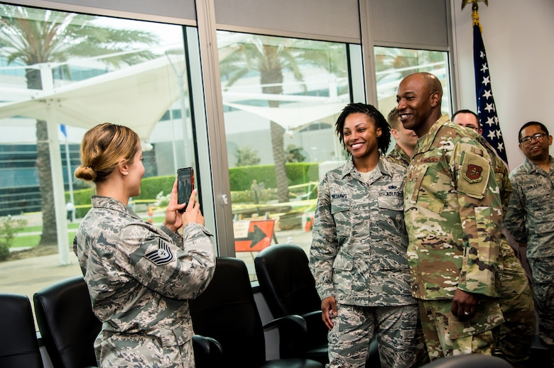 Chief Master Sergeant of the Air Force, Kaleth O. Wright takes a photo with Airmen while visiting Los Angeles Air Force Base, Sept. 26, 2019. While there, he met with Airmen, received SMC mission area briefings, and had an opportunity to view the unique characteristic of SMC and the capabilities that the total force offers to accomplish the mission at Los Angeles AFB, where space starts.
