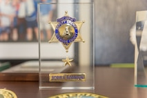 Deputy Chief Boris Robinson's Chief Deputy badge from the Riverside County Sheriff's Department captured forever in resin sits in his office at Marine Corps Logistics Base Barstow, California, Security and Emergency Services Department building 236.