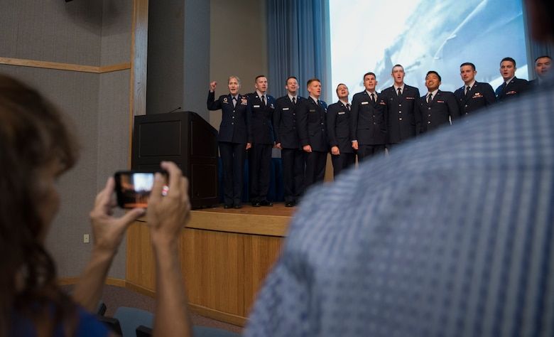 Maj. Gen. Jeannie Leavitt, Air Force Recruiting Service commander, sings the Air Force song with Specialized Undergraduate Pilot Training class 19-25 at Laughlin Air Force Base, Texas, Sept. 27, 2019. It is tradition to sing the Air Force song after every class graduation at Laughlin, and 19-25's ceremony was no exception. Leavitt, the guest speaker at the event, is also a Laughlin SUPT graduate hailing from SUPT class 93-04. (U.S. Air Force photo by Staff Sgt. Benjamin N. Valmoja)