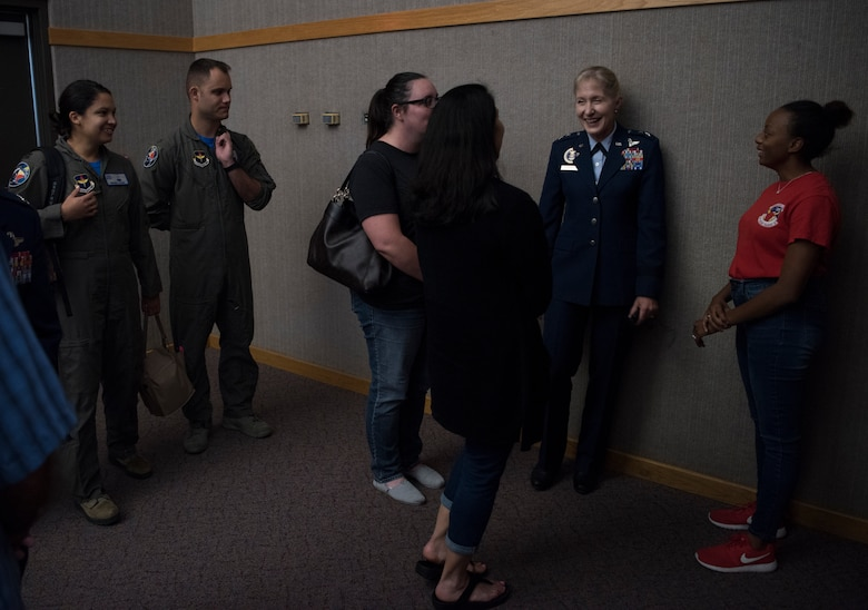 "Maj. Gen. Jeannie Leavitt, Air Force Recruiting Service commander, connects with attendees of Specialized Undergraduate Pilot Training class 19-25's graduation ceremony at Laughlin Air Force Base, Texas, Spet. 27, 2019. Leavitt returned to Laughlin to speak at SUPT class 19-25's graduation, sharing advice to the graduates. ""Work hard, live our core values, and be ready to run through that door when opportunity presents itself,"" she said. (U.S. Air Force photo by Staff Sgt. Benjamin N. Valmoja)"