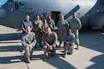 Members of the 166th Maintenance Operation Flight next to a C-130H2 aircraft on the flight line of the 166th Airlift Wing. The 166th MOF tracks and manages the maintenance of the wing's 8 C-130H2 tactical airlift aircraft, keeping them mission-ready. (U.S. Air National Guard Photo by Mr. Mitch Topal)