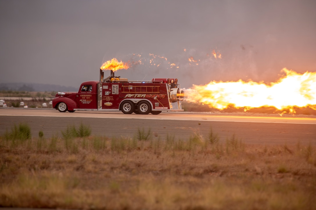 Aftershock, a jet powered firetruck,  races down the flight line at the 2019 Marine Corps Air Station Miramar Air Show on MCAS Miramar, Calif., Sept. 27. This year's air show honors first responders by featuring several performances and displays that highlight first responders and their accomplashments.