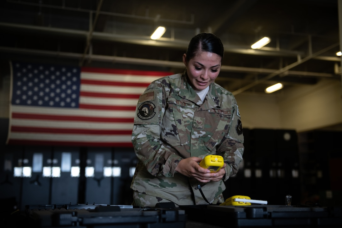 U.S. Air Force Staff Sgt. Jessica Reyes, 18th Security Forces Squadron police services craftsman, prepares breathalyzer equipment during Air Force Immersion Day, Sept. 23, 2019, at Kadena Air Base, Japan. Air Force Immersion Day is a new community engagement program hosted by the base to teach college and vocational students about the 18th Wing's role in supporting and defending U.S. and Japanese alliance. (U.S. Air Force photo by Staff Sgt. Micaiah Anthony)