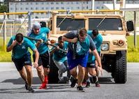 U.S. Marines with Combat Logistics Regiment 3, 3rd Marine Logistics Group, pull a humvee during the inaugural Ultimate Battle and Fear Factor Challenge at Camp Foster, Okinawa, Japan, Sept. 27, 2019.