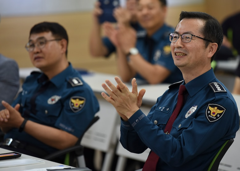 Sang-joon Lim, Gunsan Korean National Police chief, claps along to the U.S. Air Force Band of the Pacific in Gunsan City, Republic of Korea, Sept. 24, 2019. The band was established over 75 years ago but did not settle in its current location of Yokota Air Base, Japan until 1988. (U.S. Air Force photo by Staff Sgt. Anthony Hetlage)