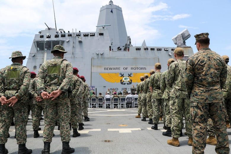 CELEBES SEA (Sept. 30, 2019) U.S. Marines with 3rd Marine Division, Sailors with the amphibious transport dock ship USS Green Bay (LPD 20) and service members with the Malaysian Armed Forces (MAF) hold an opening ceremony for exercise Tiger Strike 2019. Tiger Strike focuses on strengthening combined U.S. and Malaysian military interoperability and increasing combat readiness through amphibious operations and cultural exchanges between the MAF and the U.S. Navy, Marine Corps team.