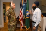 Gurchetan Singh recites the oath of enlistment with Brig. Gen. Jeremy Horn, Washington Air National Guard commander, during his enlistment into the WA ANG, Sept 27, 2019, on Camp Murray, Wash. Singh will be the first Sikh to enlist in the Air National Guard with a religious accommodation wavier that allows him to serve and still practice key elements of his religion.