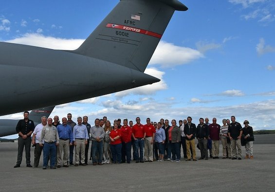 Employer Appreciation Day gusts pose for a group photo next to a C-5M Super Galaxy cargo on Westover Air Reserve Base, Massachusetts, Sept. 24, 2019. Westover ARB and the Employer Support of the Guard and Reserve hosted Reservists' civilian employers to give them an idea of what their employees do while on military status. (U.S. Air Force photo by Staff Sgt. Monica Ricci)