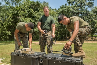 Marines set up a communications system.