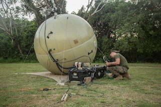 A Marine sets up a communications system