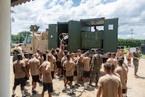 U.S. and Colombian Marines unload water from a purification plant.