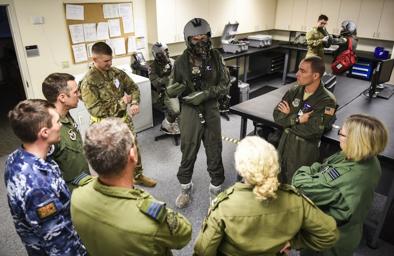 U.S. Air Force Lt. Col Kevin Parsons, center, 93rd Air Refueling Squadron commander assigned to Fairchild Air Force Base, Washington, briefs international partners before a flight Sept. 16, 2019, at Fairchild AFB during Exercise Mobility Guardian 2019. Exercise Mobility Guardian is Air Mobility Command's premier, large scale mobility exercise. Through robust and relevant training, Mobility Guardian improves the readiness and capabilities of Mobility Airmen to deliver rapid global mobility and builds a more lethal and ready Air Force. (U.S. Air Force photo by Staff Sgt. Dustin Mullen)