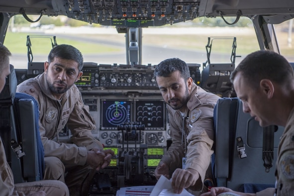 Members of a United Arab Emirates Air Force C-17A Globemaster III, discuss flight plans in preparation for their first conventional airdrop training mission, Sept. 25, 2019, while news media personnel flew aboard during an exercise on Mobility Guardian 2019 media day, over Fairchild Air Force Base, Washington. Exercise Mobility Guardian is Air Mobility Command's premier, large scale mobility exercise. Through robust and relevant training, Mobility Guardian improves the readiness and capabilities of Mobility Airmen to deliver rapid global mobility and builds a more lethal and ready Air Force. (U.S. Air Force photo by Senior Airman Charles T. Fultz)