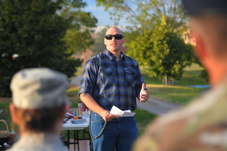 Technical Sgt. Sean Hazelip, F-22 System Program Office, addresses Airmen gathered for a Suicide Prevention Month candlelight vigil Sept. 26, 2019, at Hill Air Force Base, Utah. Hazelip shared a personal story about a time he reached out to an Airman in distress and realized after the meeting that even the smallest of kind gestures can matter to those who are suffering or in crisis. (U.S. Air Force Photo by Todd Cromar)