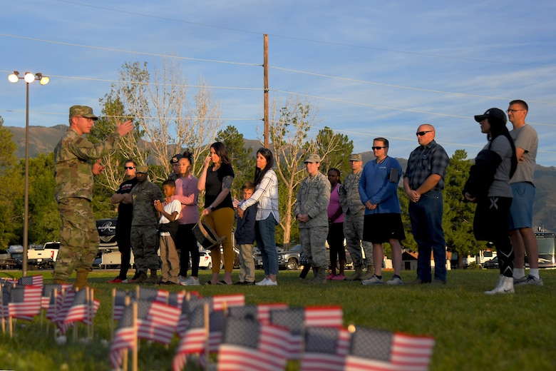 Airmen gather for a Suicide Prevention Month candlelight vigil Sept. 26, 2019, at Hill Air Force Base, Utah. Throughout the day and during the vigil, Airmen placed flags in remembrance of a family member, friend or coworker who died by suicide. (U.S. Air Force Photo by Todd Cromar)