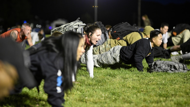 Airmen do pushups during a Suicide Prevention Month 5K ruck march/run at Hill Air Force Base, Utah, Sept. 25, 2019. (U.S. Air Force photo by R. Nial Bradshaw)