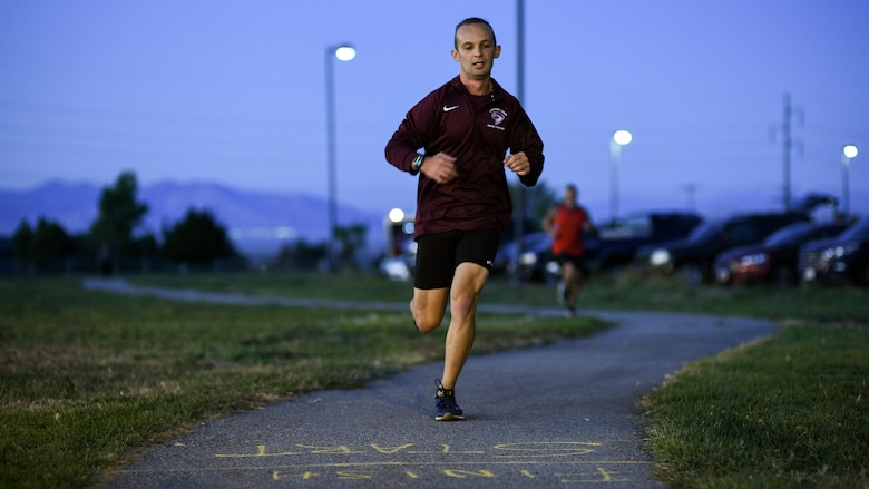 A runner nears the finish line during a Suicide Prevention Month 5K ruck march/run at Hill Air Force Base, Utah, Sept. 25, 2019. (U.S. Air Force photo by R. Nial Bradshaw)