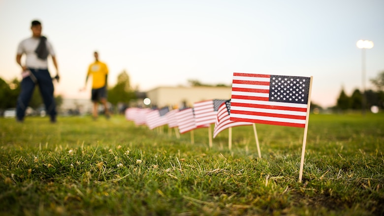 Team Hill members place flags during a Suicide Prevention Month 5K ruck march/run at Hill Air Force Base, Utah, Sept. 25, 2019. Throughout the day and during the march, Airmen placed flags in remembrance of a family member, friend or coworker who died by suicide. (U.S. Air Force photo by R. Nial Bradshaw)