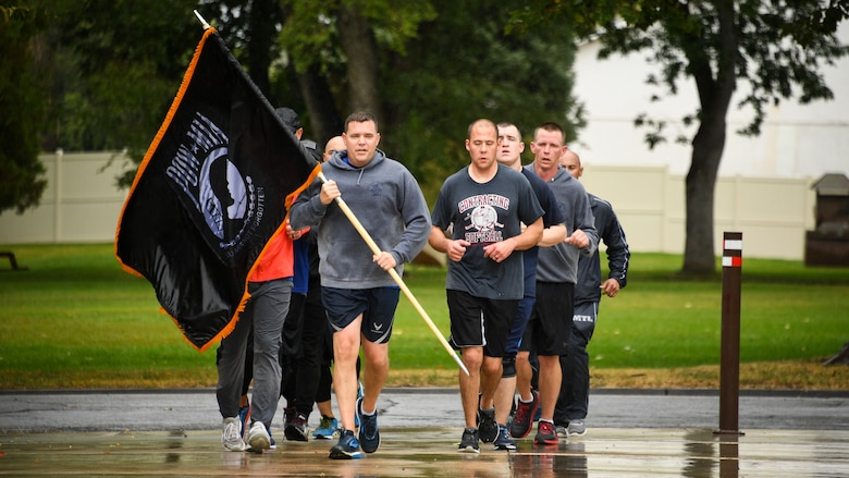 The first sergeants council carry the POW/MIA flag during the last leg of of a 24-hour remembrance day run at Hill Air Force Base, Utah, Sept. 20, 2019. The flag was kept in constant motion for 24 hours during the event. (U.S. Air Force photo by R. Nial Bradshaw)