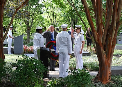 SUITLAND, Md. (Sept. 11, 2019) Office of Naval Intelligence (ONI) Commander Rear Adm. Kelly Aeschbach and retired Capt. Tom Bortmes lay a memorial wreath during a Sept. 11 remembrance ceremony at the National Maritime Intelligence Center.