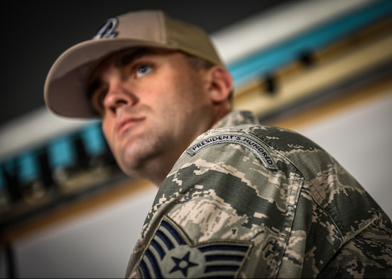 Tech. Sgt. Andrew Wilson, a specialist expeditor assigned to the 757th Aircraft Maintenance Squadron, poses for a photo at Nellis Air Force Base, Nevada, Sept. 17, 2019. Wilson started shooting consistently in late 2017 and earned his first President's Hundred Tab in July of 2018. The tab is awarded for placing within the top 100 in the President's shooting matches. (U.S. Air Force photo by Airman 1st Class Dylan Murakami)