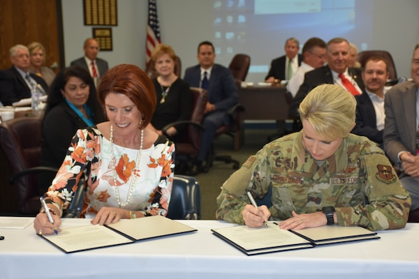 Brig. Gen. Laura Lenderman, commander, 502nd Air Base Wing and Joint Base San Antonio, and Diane Rath, Alamo Area Council of Governments executive director, signed a historical agreement at the AACOG Board of Directors meeting Sept. 25. This new blanket Intergovernmental Support Agreement, or IGSA, will afford JBSA the opportunity to bring requirements they would normally fill through traditional federal contracting actions to AACOG.