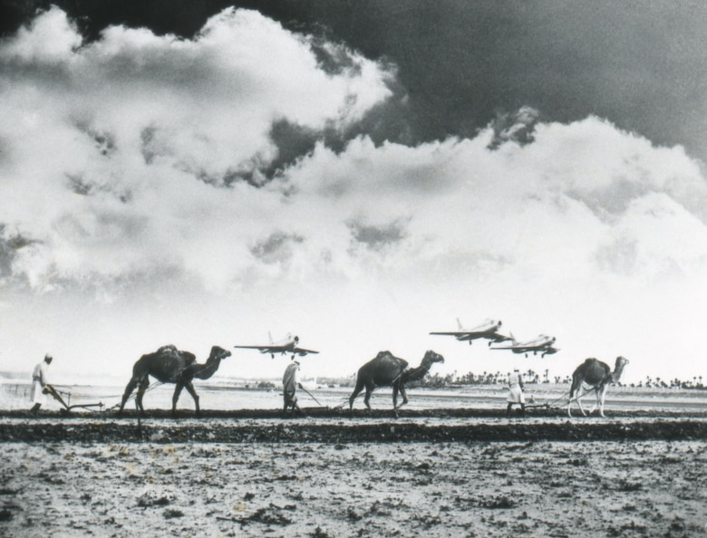 Progress versus the primitive: fighter planes fly over camels in Morocco.