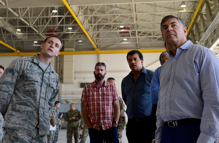 Members of the Defense Innovation Board (DIB), Defense Innovation Unit (DIU) and Defense Digital Services (DDS) receive a brief from an Airman at an MQ-9 Reaper display at Creech Air Force Base, Nevada, Sept. 12, 2019. The group is made up of prominent business leaders, scholars, inventors, and scientists such as the director of the Hayden Planetarium, Neil Degrasse Tyson. (U.S. Air Force photo by Senior Airman Haley Stevens)