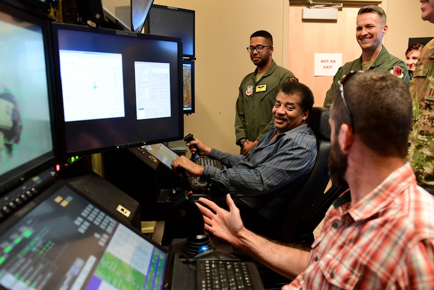 Members of the Defense Innovation Board (DIB) and Defense Digital Services (DDS) fly an MQ-9 Reaper flight simulator at Creech Air Force Base, Nevada, Sept. 12, 2019. The RPA enterprise is ever-changing, growing, and evolving to keep ahead of the nation's adversaries. Without the bright minds and creative ideas of Airmen and DOD partners, the continued progression of the MQ-9 mission would not be possible. (U.S. Air Force photo by Senior Airman Haley Stevens)