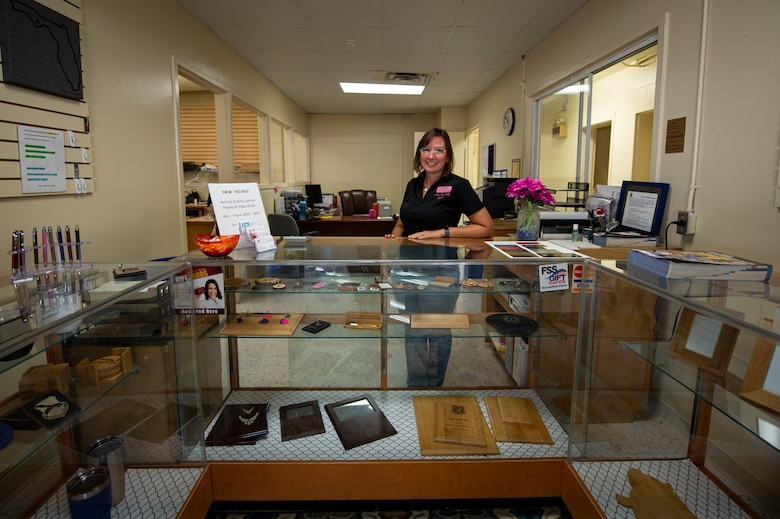 Vikki Dalton, 325th Force Support Squadron Arts and Crafts Center manager, stands at the front desk of the Arts and Crafts Center on Tyndall Air Force Base, Fla., Sept. 24, 2019. The Arts and Crafts Center offers a wide varies of personalized items and crafty classes. (U.S. Air Force photo by Airman 1st Class Bailee A. Darbasie)