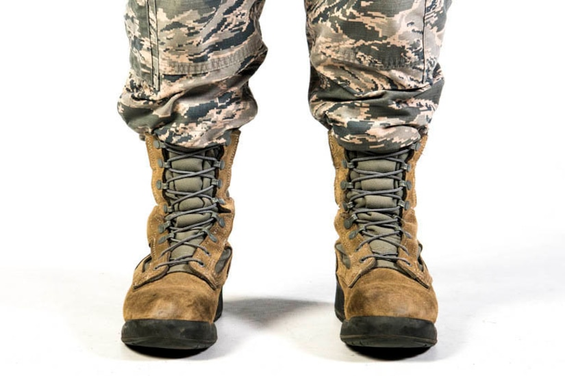 Studio shot of the feet and lower legs of an airman wearing combat boots.