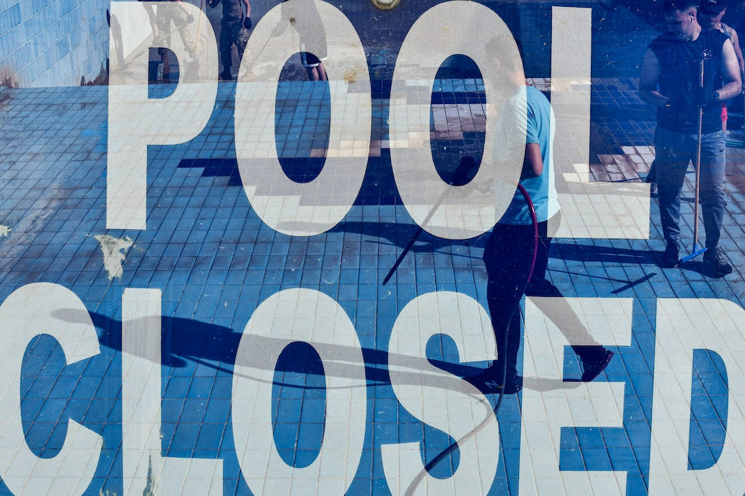 Airmen cleaning pools