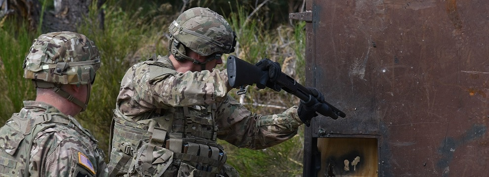 A Dutch Soldier uses an M500 shotgun to breach a door during the Urban Breach Training  at the Grafenwoehr Training Area, Germany, Aug. 29. 2018. U.S. Soldiers assigned to the 7th Army Combined Arms Training Center (CATC), 7th Army Training Command, instructed U.S. Soldiers assigned to various units across Europe, Latvian soldiers and Dutch soldiers on how to conduct urban breaching and offered new techniques for entering hostile or unknown buildings. (U.S. Army photo by Spc. Craig Carter)