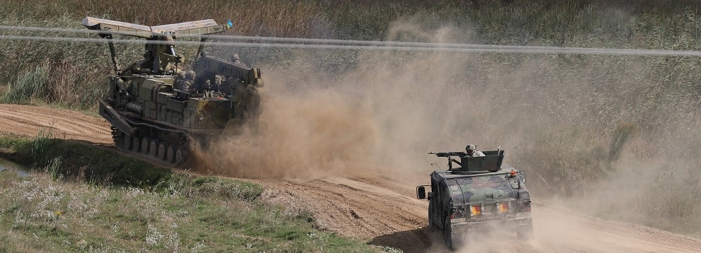 A high mobility multi-wheeled vehicle from the 101st Airborne Division (Air Assault) provides fire support for a Ukraine engineer vehicle during a water gap crossing demonstration as part of Rapid Trident 2019 in Yavoriv, Ukraine, Sept. 20, 2019. RT19 is an annual, multinational exercise occurring from Sept. 13-28, 2019, which involves approximately 3,700 personnel from 14 nations, that supports joint combined interoperability among partner militaries of Ukraine and the United States, as well as Partnership for Peace nations and NATO allies. (U.S. Army photo by Sgt. Kyle Larsen)