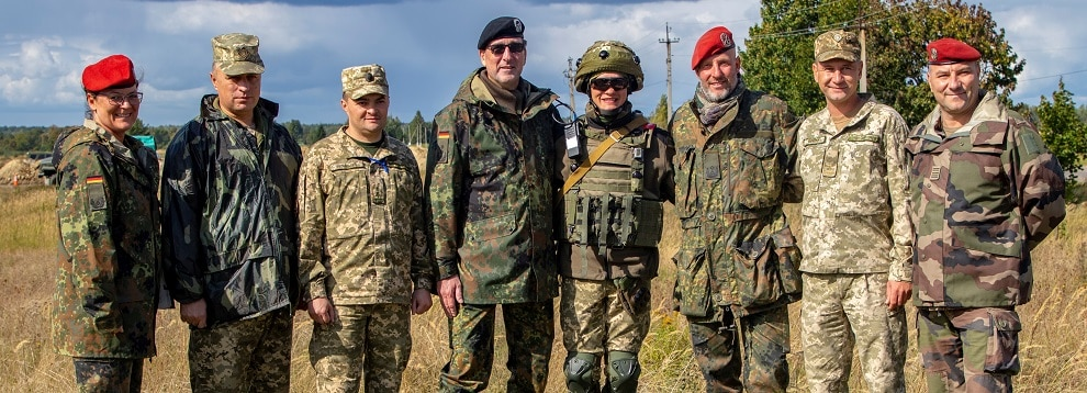 Operational capabilities concept evaluators pose for a photo during a walkthrough of a situational training exercise, as part of Rapid Trident 2019, Sept. 19, 2019, near Yavoriv, Ukraine. RT19 is an annual, multinational exercise, which involves approximately 3,700 personnel from 14 nations, that supports joint combined interoperability among partner militaries of Ukraine and the United States, as well as Partnership for Peace nations and NATO allies. (U.S. Army photo by Pfc. Caleb Minor)