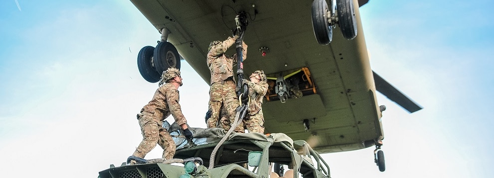 U.S. Army paratroopers assigned to the 173rd Airborne Brigade sling-load an Army Ground Mobility Vehicle (AGMV) to a CH-47 Chinook helicopter during Exercise Saber Junction 2019 in Grafenwoehr Training Area, Germany. Sept. 15, 2019. (U.S. Army photo by Sgt. Henry Villarama)