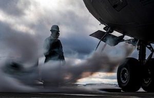 Senior Airman Zachary Anderson, 911th Aircraft Maintenance Squadron crew chief, observes excess liquid oxygen bleed-out from a C-17 Globemaster III at the Pittsburgh International Airport Air Reserve Station, Pennsylvania, March 10, 2020.