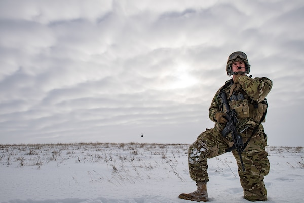 Senior Airman, response force leader with 791st Missile Security Forces Squadron, performs security sweep of landing zone near Minot Air Force Base, North Dakota, on January 25, 2017 (U.S. Air Force/Brandon Shapiro)