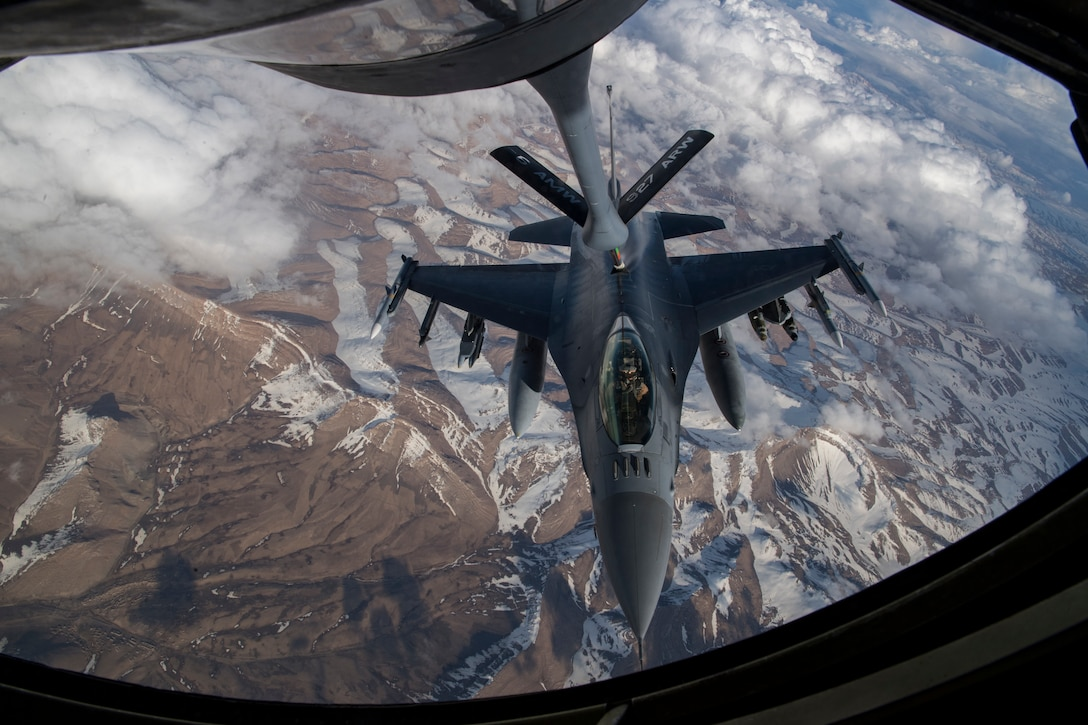 A U.S. Air Force F-16 Fighting Falcon receives fuel from a U.S. Air Force KC-135 Stratotanker assigned to the 28th Expeditionary Air Refueling Squadron over Afghanistan, March 17, 2020. The F-16 Fighting Falcon is a compact, multi-role fighter aircraft that delivers war- winning airpower to the U.S. Central Command area of responsibility. (U.S. Air Force photo by Tech. Sgt. Matthew Lotz)